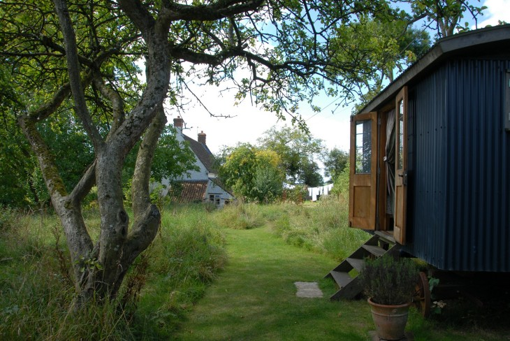 Shepherd's Hut B&B  with cottage where Steinbeck stayed in the background.JPG
